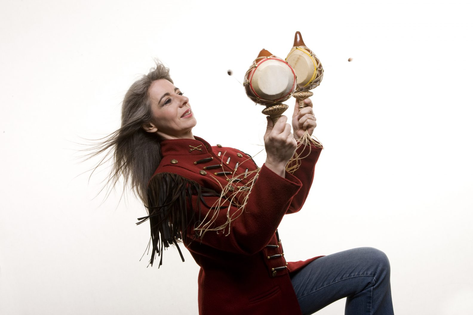 Photograph of Evelyn Glennie playing percussion