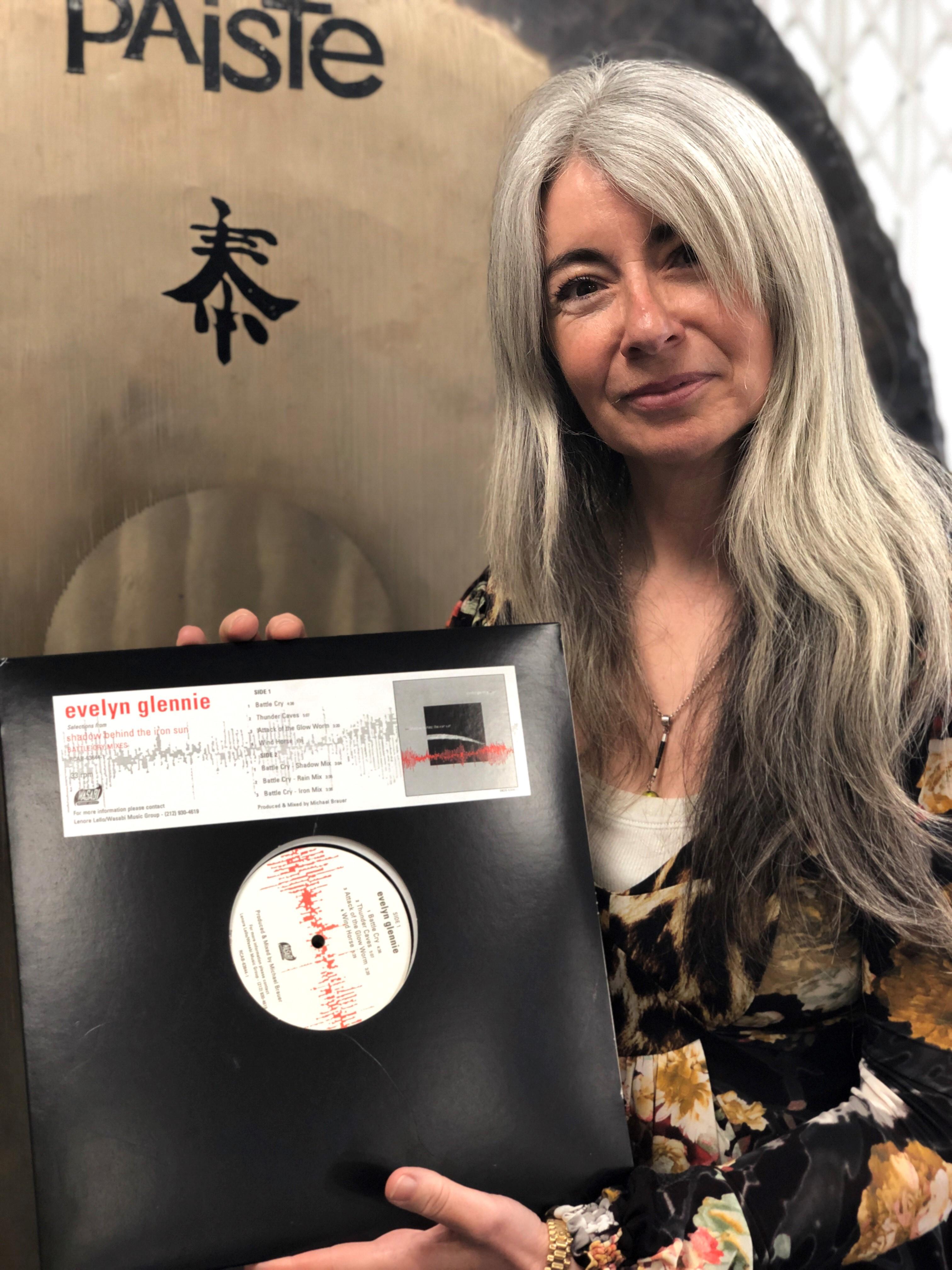 Evelyn Glennie with her Shadow Behind Iron Sun Vinyl